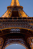 detail at night stock photography | France, Paris, Eiffel Tower at night with moon, image id 6-450-6365