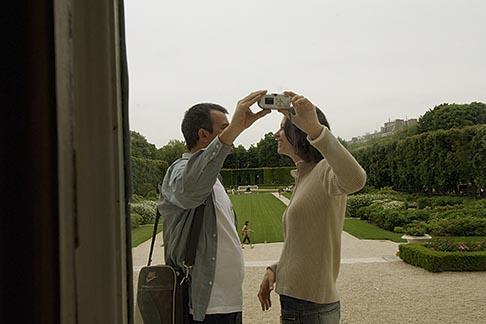 image 6-450-6666 France, Paris, Rodin Museum, Couple taking photos