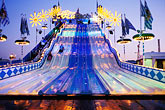 fairgrounds at night stock photography | Germany, Munich, Oktoberfest, Fun slide at night, image id 3-952-87