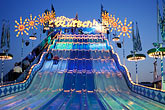 fairgrounds at night stock photography | Germany, Munich, Oktoberfest, Slide at night, image id 3-953-22