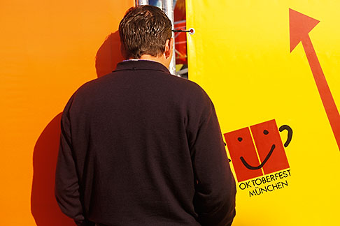 image 3-954-41 Germany, Munich, Oktoberfest, Looking through the fence