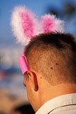vertical stock photography | Germany, Munich, Oktoberfest, Man with rabbit ears, image id 3-954-51