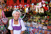 one woman only stock photography | Germany, Munich, Oktoberfest, Souvenir vendor, image id 3-954-98
