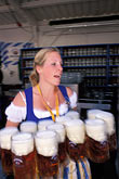 one woman only stock photography | Germany, Munich, Oktoberfest, Waitress with beers, image id 3-955-12