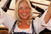 smile stock photography | Germany, Munich, Oktoberfest, Woman in beer hall, image id 3-955-53