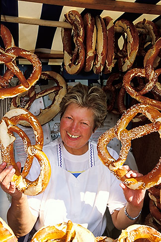 image 3-955-74 Germany, Munich, Oktoberfest, Woman with pretzels