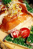 vertical stock photography | Germany, Munich, Oktoberfest, Radi, radish plate with Bavarian ham, image id 3-956-11