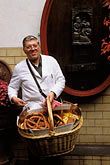 vertical stock photography | Germany, Frankfurt, Pretzel man, Zum Gemalten Haus tavern, image id 5-551-6