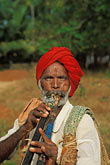 vertical stock photography | India, Goa, Itinerant musician, Anjuna, image id 0-605-20
