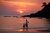 father and child stock photography | India, Goa, Sunset, Baga Beach, image id 0-609-48