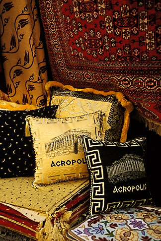 image 3-653-91 Greece, Athens, Pillows and fabrics for sale in market