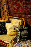 souvenirs in shop stock photography | Greece, Athens, Pillows and fabrics for sale in market, image id 3-653-91