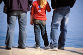 three men stock photography | Greece, Hydra, Waterfront, Three pairs of jeans, image id 3-700-97