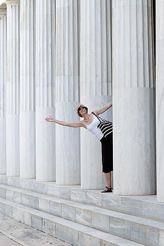 image 7-640-5015 Greece, Woman leaning out from portico of Greek columns