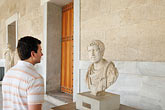 tourist stock photography | Greece, Athens, Tourist, face to face with ancient statue, image id 7-640-5028