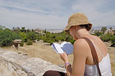 reading guidebook stock photography | Greece, Athens, Tourist reading guidebook, image id 7-640-5042