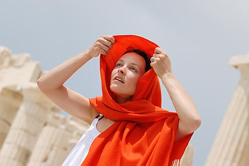 image 7-640-5464 Greece, Woman in white dress with red shawl