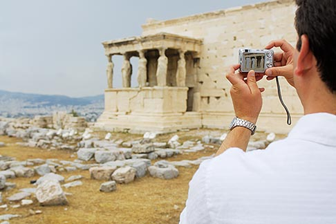 7-640-695  stock photo of Greece, Athens, Acropolis, Tourist photographing the Porch of the Caryatids, Erectheion