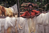 coast stock photography | India, Kerala, Fisherman with nets, image id 7-132-14