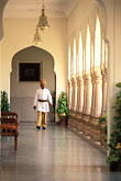 hallway stock photography | India, Jaipur, Man walking in hallway, Rambagh Palace, image id 7-339-19
