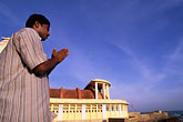 men praying stock photography | India, Tamil Nadu, Prayer at Gandhi Memorial, Kanya Kumari, image id 7-74-29