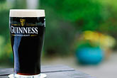 closeup stock photography | Ireland, Dublin, Glass of Guinness beer, image id 4-751-87