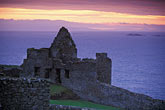 evening stock photography | Northern Ireland, County Antrim, Dunluce Castle, image id 4-752-8