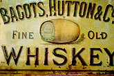 red stock photography | Ireland, Dublin, Bagots, Hutton & Co. whiskey sign, image id 4-900-1627