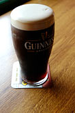 glass of guinness ale stock photography | Ireland, County Galway, Guinness Beer, image id 4-900-881