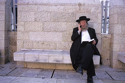 image 9-350-8 Israel, Jerusalem, Man with cellphone, Western Wall
