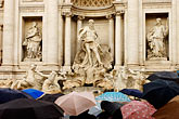 horizontal stock photography | Italy, Rome, Umbrellas, Trevi Fountain, image id S4-501-4220