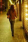 night stock photography | Italy, Milan, Lady walking down the street, image id S4-510-7074