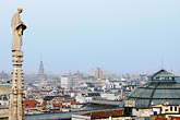 design stock photography | Italy, Milan, Statue and View of Milan from the Rooftop of the Duomo, image id S4-511-7169