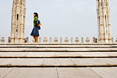 temple roof stock photography | Italy, Milan, Lady walking on Duomo rooftop, image id S4-511-7202
