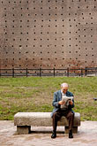 on ones own stock photography | Italy, Milan, Man reading the paper, Castello Sforzesco, image id S4-512-7423