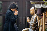 buddhist temple stock photography | Japan, Tokyo, Asakusa Kannon Temple, Woman praying, image id 5-850-2003