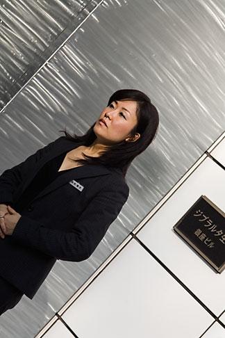image 5-850-2637 Japan, Tokyo, Woman outside shop