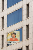 woman and child stock photography | Japan, Tokyo, Office building and poster, image id 5-850-2646