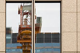 reflection in office building stock photography | Japan, Tokyo, Crane reflection in window, image id 5-850-2845