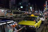 yellow stock photography | Japan, Kyoto, Taxis at night, image id 5-855-2481