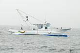 fog stock photography | Japan, Yokohama, Fishing boat in fog, image id 7-675-7604