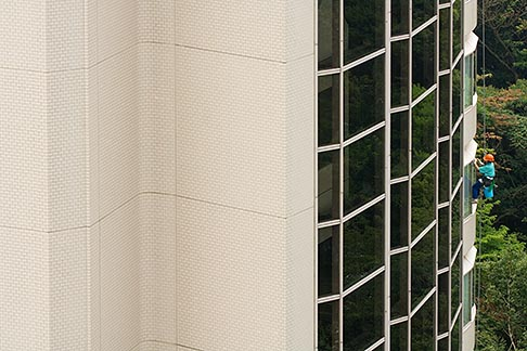 image 7-680-4285 Tokyo, Japan, Man washing outside windows of high rise office building