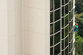 tokyo stock photography | Tokyo, Japan, Man washing outside windows of high-rise office building, image id 7-680-4285