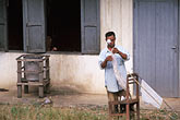 care stock photography | Laos, Phon Hong Hospital, Patient changing bandages, image id 8-560-30