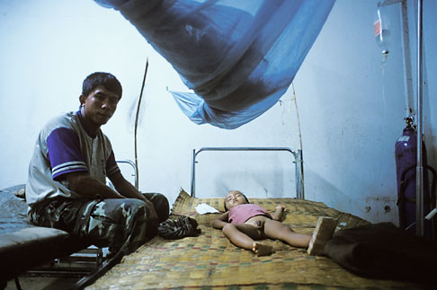 image 8-580-3 Laos, Vang Vieng Hospital, Boy with dengue fever