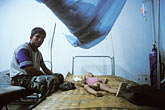 vang vieng stock photography | Laos, Vang Vieng Hospital, Boy with dengue fever, image id 8-580-3