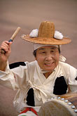mature women only stock photography | South Korea, Andong , Mask Dance Festival, Woman with drum, image id 2-702-7