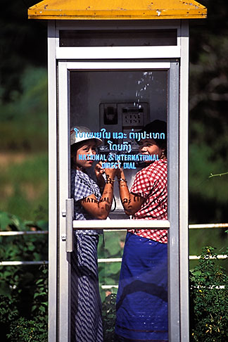 image 8-570-2 Laos, Young women in phone booth