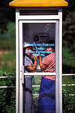 third world stock photography | Laos, Young women in phone booth, image id 8-570-2
