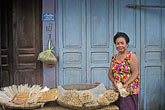 horizontal stock photography | Laos, Vientiane Province, Woman selling  sticks, Phon Hong, image id 8-571-17